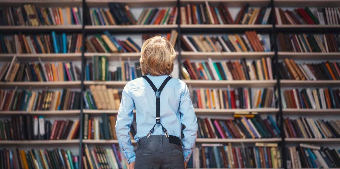 boy_in_front_of_books